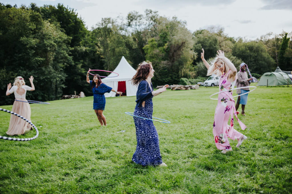 Guests playing with hoola hoop - tipi wedding - Sussex Wedding Photography