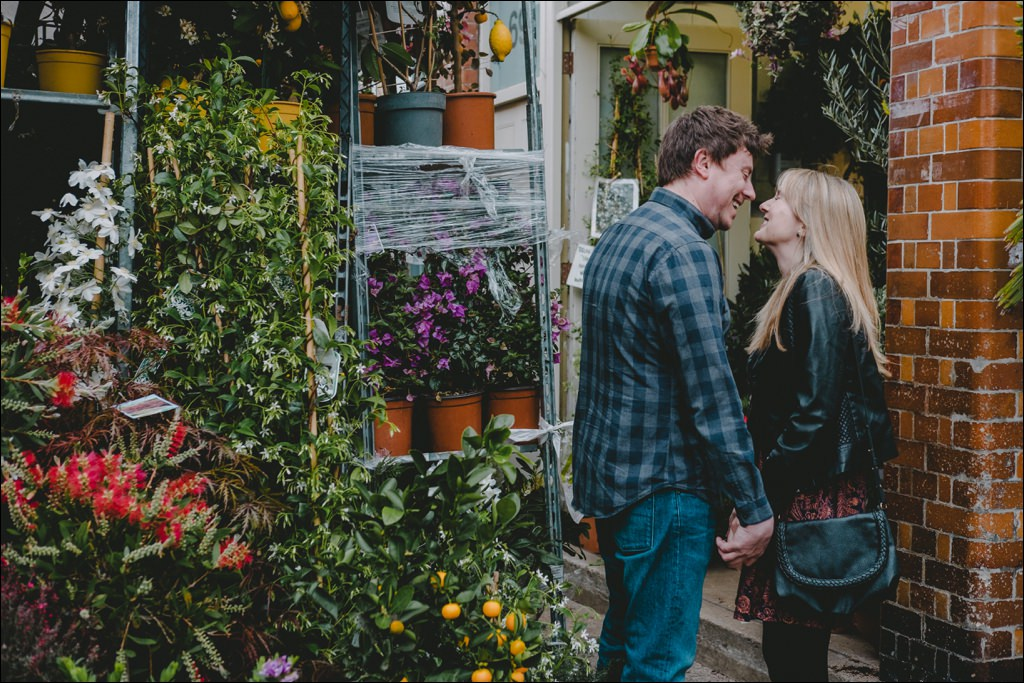 Couple at the Columbia Road Flower Market at their Shoreditch engagement shoot