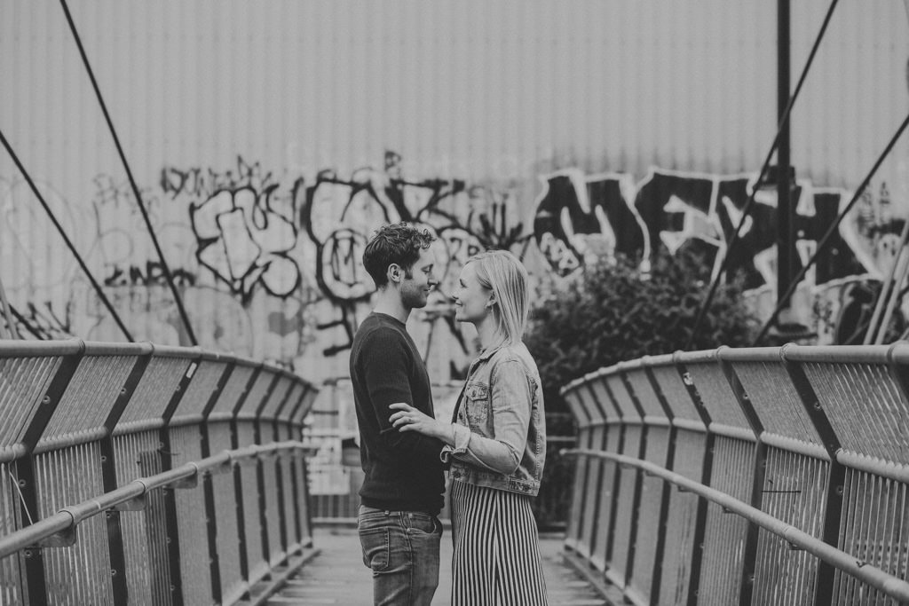 Engagement shoot by the street art in Hackney
