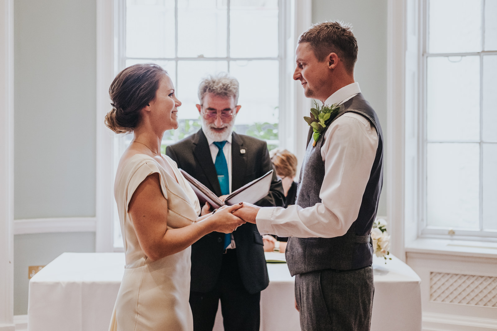 Bride and groom exchanging rings at the Asia House - Modern London wedding