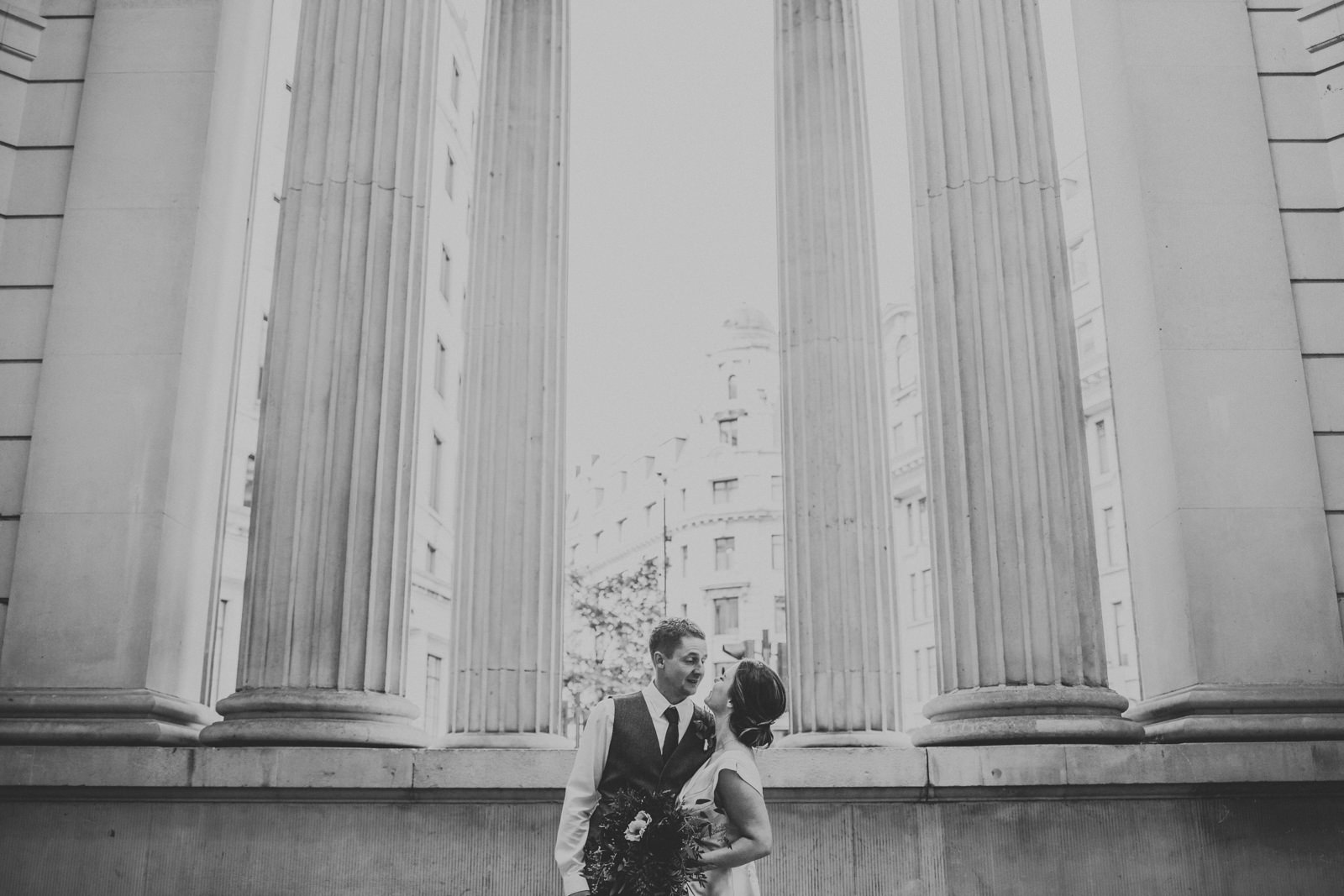 Bride and groom posing in Bank  - Modern London wedding