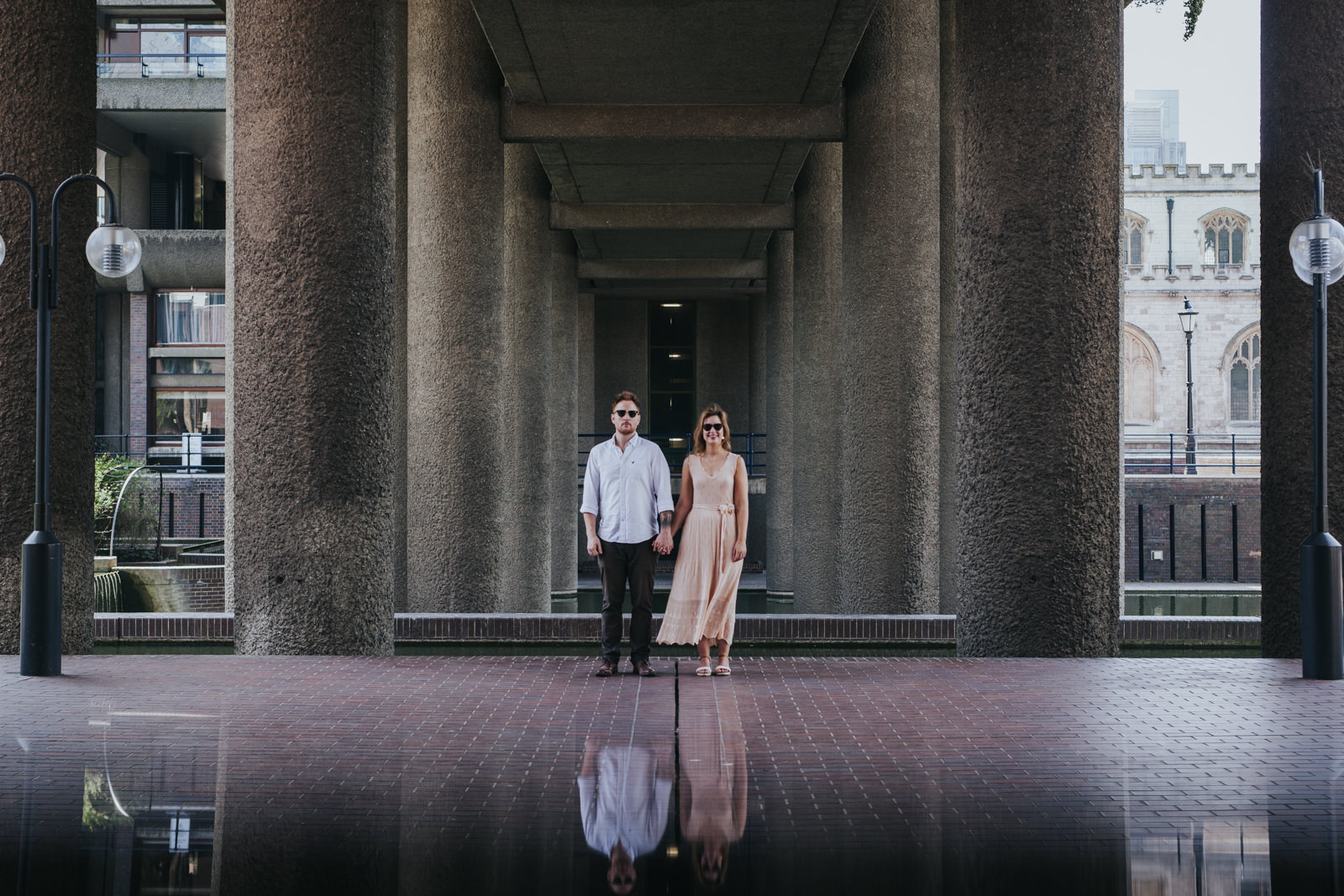 Couple holding hands at their Barbican engagement shoot