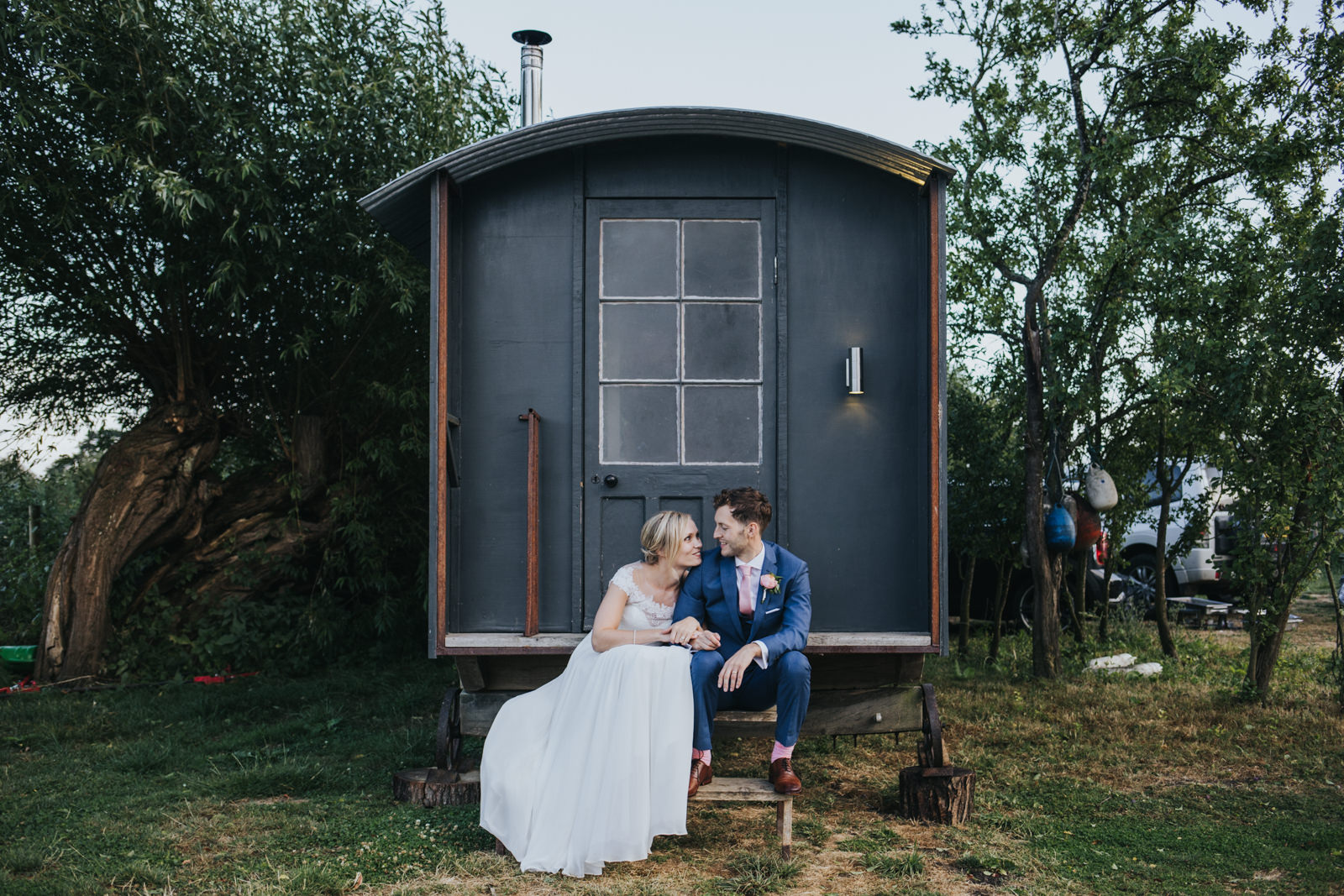 Bride and groom in front of the caravan at Maybush Weddings in Witney  - Oxfordshire tipi wedding