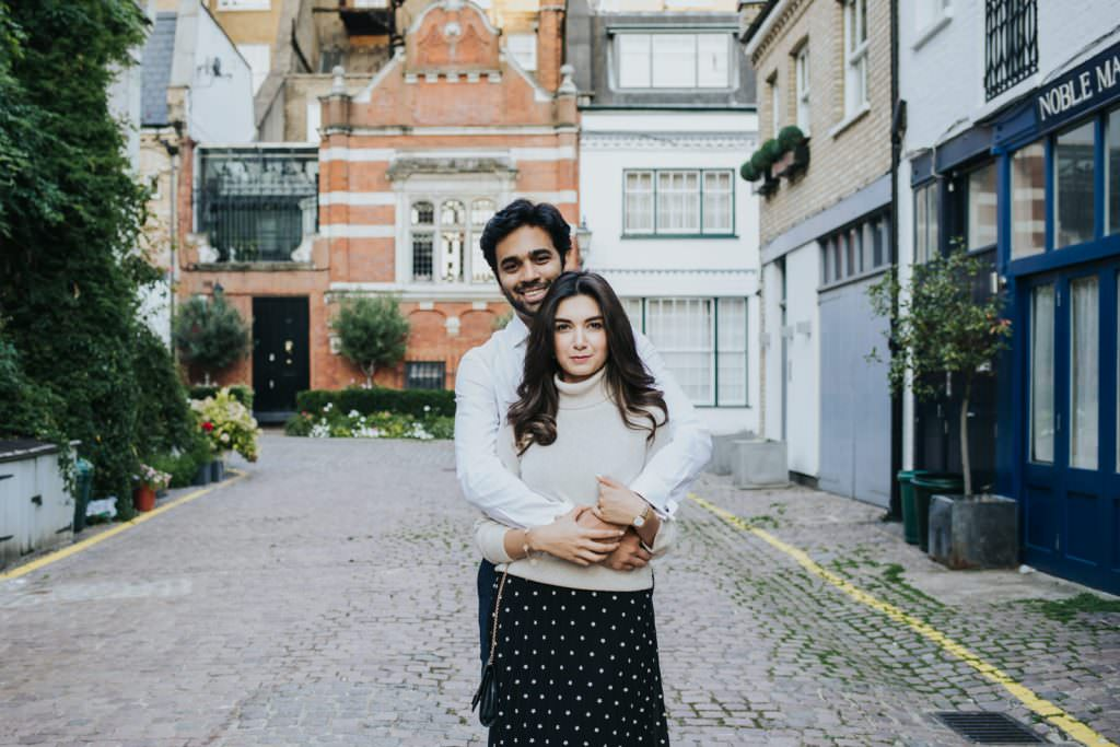 Couple holding each other in mews of South Kensington couple shoot
