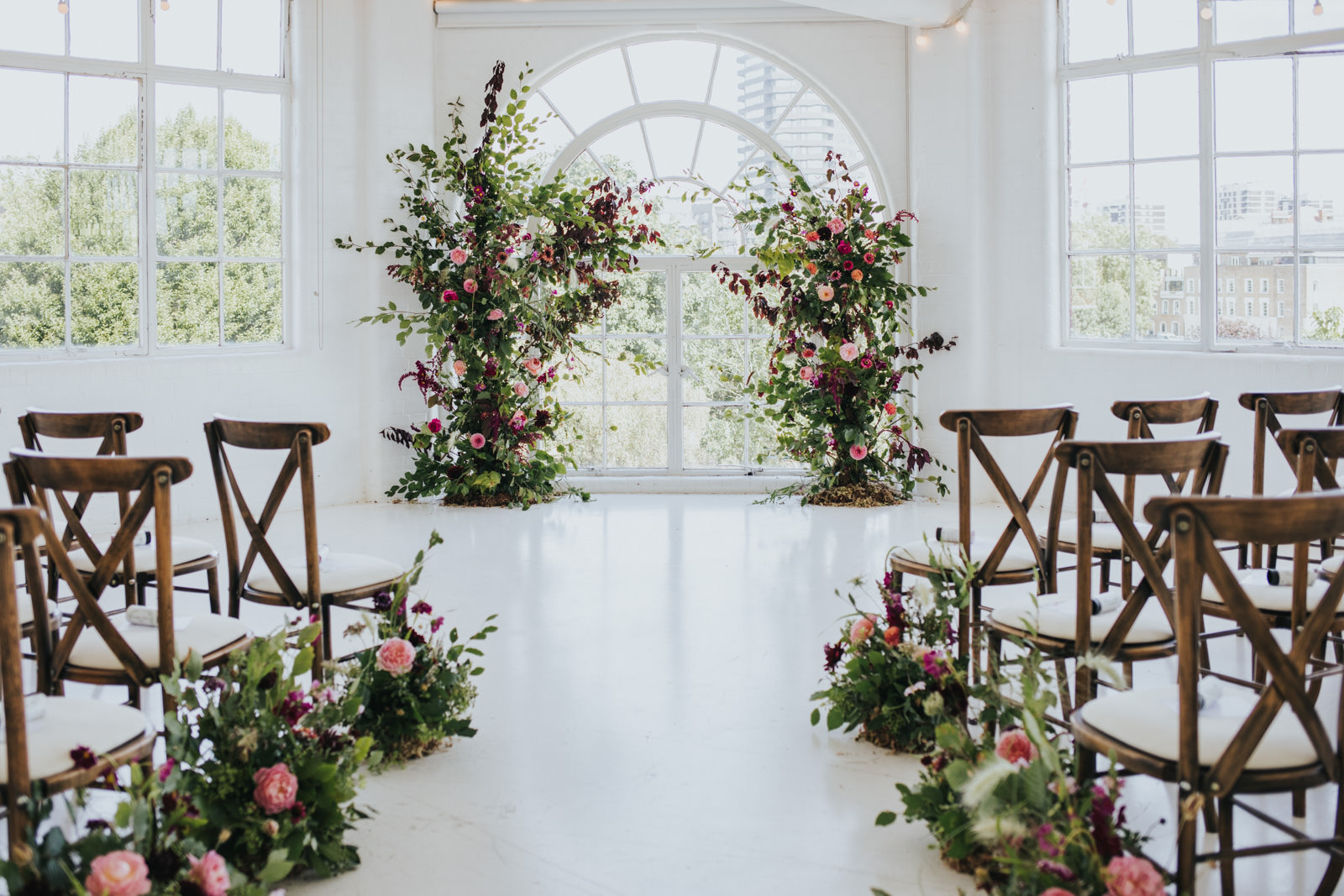Decorations at the Wimbourne House wedding with floral arch by Petal HQ