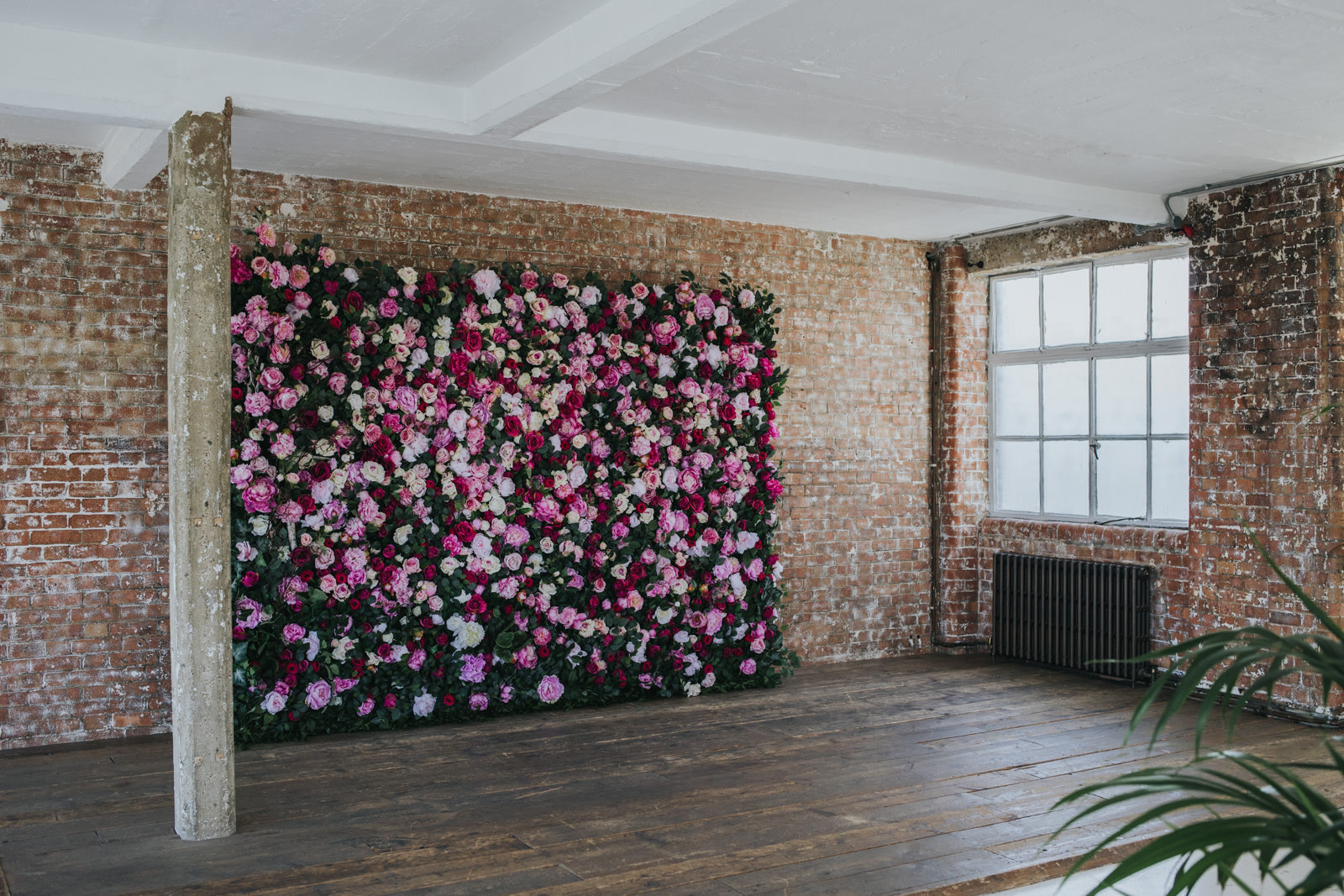 Decorations at the Wimbourne House wedding in Shoreditch with flower wall