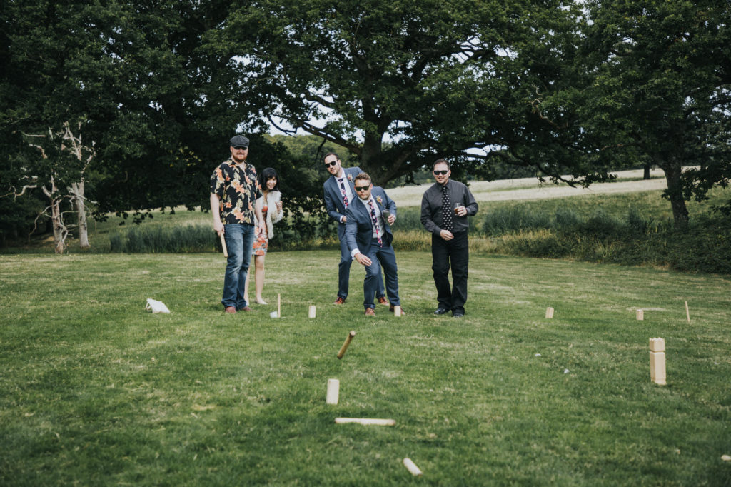 Guests playing games at the festival wedding - Sussex wedding photography