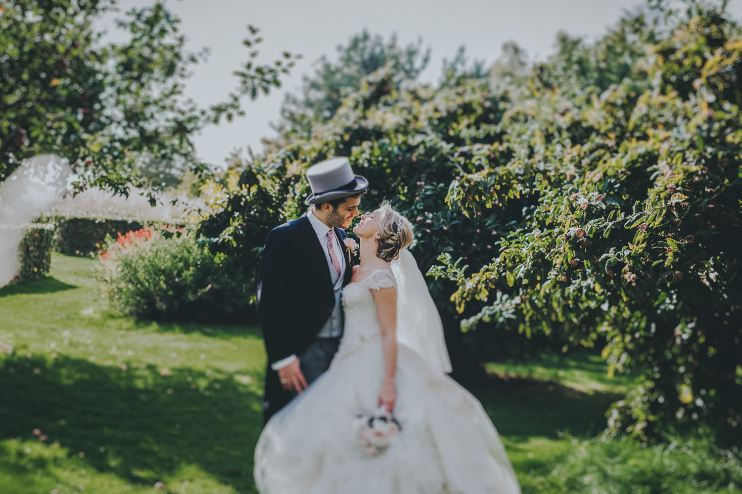 Bride and groom in the apple orchard - Wisley Garden Wedding