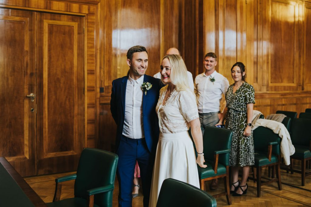 Intimate wedding ceremony at the Hackney Town Hall - bride and groom smiling during the ceremony