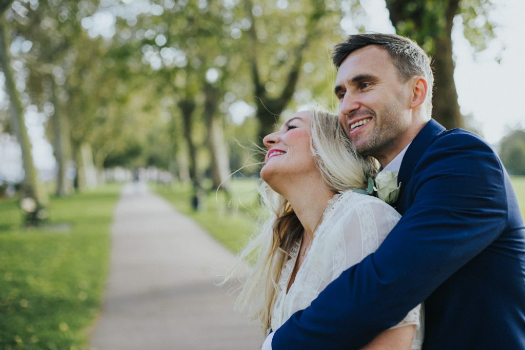 Intimate wedding ceremony in Hackney - couple cuddling in the hackney downs park