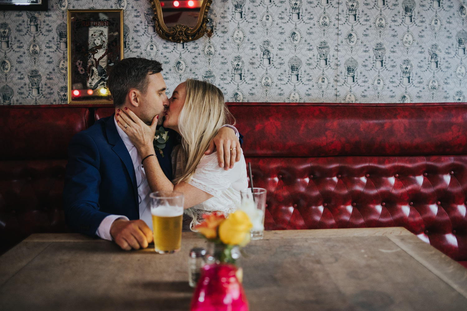 Intimate wedding ceremony in Hackney - couple kissing in the pub