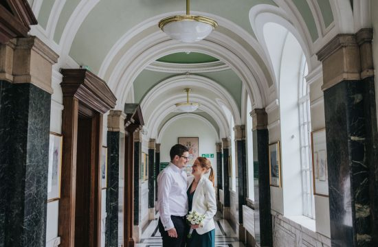 Intimate Islington Town Hall wedding - couple in the hallway