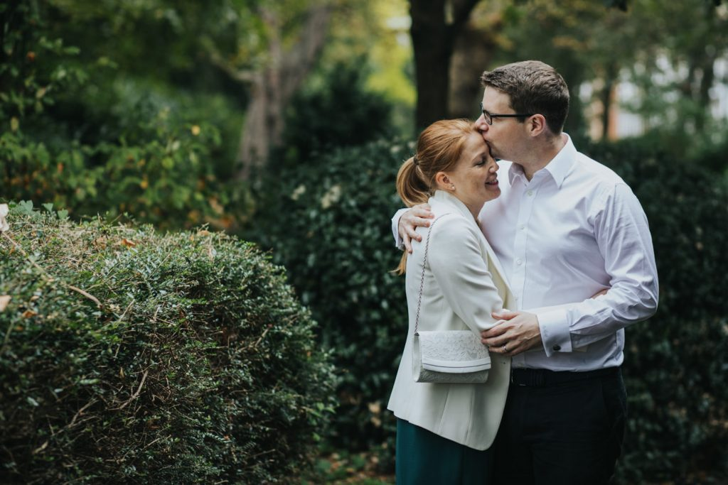 Intimate Islington Town Hall wedding - couple cuddling in the park