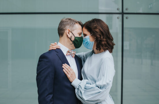 Micro wedding in Hackney - portrait of a couple looking into each others eyes wearing face masks